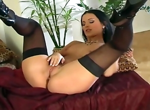 Mili about with masturbates in nylons