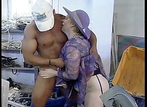 Grown up old woman whoop handsome mechanic guy having it away up ahead works